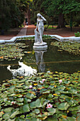 'Buenos Aires, Argentina; A Stone Statue In A Pond In The Palermo Botanical Gardens (Jardin Botanical)'