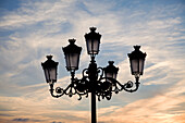 'Medina Sidonia, Andalusia, Spain; A Light Post With 5 Lamps On It'