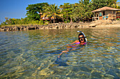 'Roatan, Bay Islands, Honduras; A Young Woman Snorkeling At Anthony's Key Resort'