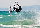 'A Man Kitesurfing Off Dos Mares Beach In Front Of Hotel Dos Mares; Tarifa, Cadiz, Andalusia, Spain'