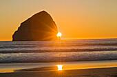 'Sunburst And Haystack Rock At Cape Kiwanda; Pacific City, Oregon, Usa'