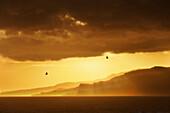 'Sun Breaking Through The Dark Clouds; Tarifa, Cadiz, Andalusia, Spain'