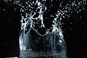 A Drop Of Water Landing And Splashing