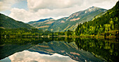 'Mountains Reflected In A Tranquil Lake; Golden British Columbia, Canada'