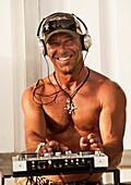 'A Disc Jockey Playing Music At Explora Beach Bar; Tarifa, Cadiz, Andalusia, Spain'