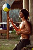 'A Man Playing With A Beach Ball At Explora Beach Bar; Tarifa, Cadiz, Andalusia, Spain'