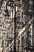 'Fire Escapes Going Up The Side Of A Building; Manhattan, New York City, New York, United States Of America'