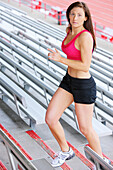 'A Woman Running Up The Stands At A Sports Stadium For Exercise; Troutdale, Oregon, United States Of America'