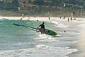 'A Man On The Beach With His Windsurfing Board; Tarifa, Cadiz, Andalusia, Spain'