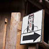 'Direction Sign With Drawing Of Woman; Huay Pu Keng, Thailand'