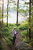 'Girl Walking Through The Forest To The Lake; Kristiansand, Norway'