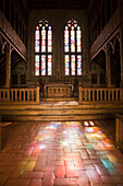 'Church Interior At The Bragance Palace With Colourful Light Reflections Shining Through The Stained Glass Windows Onto The Floor; Guinaraes, Portugal'
