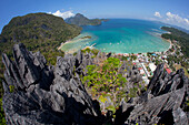 'An Aerial Fisheye View From The Top Of Sharp Limestone Spires Overlooking The Village Of El Nido; El Nido, Bacuit Archipelago, Palawan, Philippines'