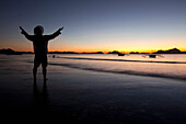 'A Man On A Beach At Sunset; Corong-Corong, Palawan, Philippines'