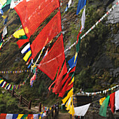 'Prayer Flags Hanging Over A Wooden Walkway At Tiger's Nest Monastery; Paro Valley, Taktsang, Bhutan'