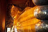 'Golden Buddha At Wat Pho, Temple Of The Reclining Buddha; Bangkok, Thailand'