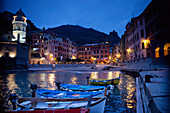 'Boats Moored By Buildings Along The Waterfront At Night; Vernazza, Liguria, Italy'