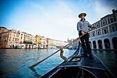 'A Gondolier Rowing A Gondola; Venice, Venezia, Italy'