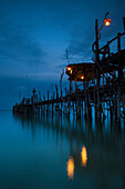 'Lights On A Wooden Pier Leading Out In The Water At Night; Kho Samet, Thailand'