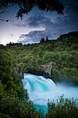 'A Waterfall Surrounded By A Forested Area; New Zealand'