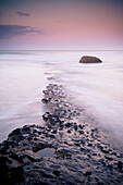 'Mist Over The Water Washing Over The Rock; Cape Foulwind, South Island, New Zealand'