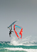 'A Windsurfer Flips Upside Down On The Water Off Valdevaqueros Beach; Tarifa, Cadiz, Andalusia, Spain'