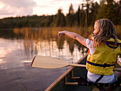 'Lake Of The Woods, Ontario, Canada; Girl In A Canoe'