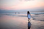'Puerto Vallarta, Mexico; Girl Walking On The Beach'