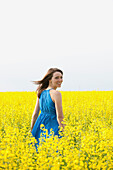 A Young Woman In A Canola Field