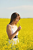 Young Woman In A Canola Field