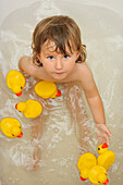 Girl In The Bathtub With Rubber Ducks