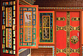 Row Of Colorful Open Windows At A Buddhist Monastery In Nepal
