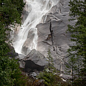 'Water Cascading Down The Rock And Forming A Mist In Jasper National Park; Alberta, Canada'