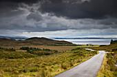 'A Country Road Through A Hilly Landscape Along The Coast; Ardnamurchan, Argyl, Scotland'