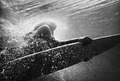 'A Woman On A Surfboard Under The Water; Tarifa, Cadiz, Andalusia, Spain'