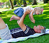 'Father And Young Daughter Spending Quality Time Together In A Park; Edmonton, Alberta, Canada'