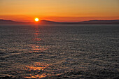 'View Of Sunset From Rossbeigh Beach On The Iveragh Peninsula Or Ring Of Kerry; County Kerry, Ireland'