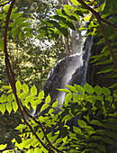 'Waterfall Framed By Green Leaves In The Natural Park Monasterio De Piedra; Zaragoza Province, Aragon, Spain'
