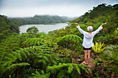 'A Female Tourist Stands Among Tropical Plants That Grow Around The Twin Lakes At Twin Lakes National Park; Island Of Negros, Philippines'