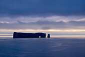 'Rock Formation Perce Rock In The Water In Shades Of Blue; Perce, Quebec, Canada'