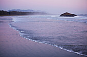 'A Pink Sky Forms At Sunset At Long Beach A Surfer's Paradise In Pacific Rim National Park Near Tofino; British Columbia, Canada'