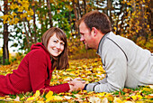 'Young Married Couple Spending Quality Time Together In A Park In Autumn; Edmonton, Alberta, Canada'