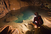 'A Filipino Tour Guide Holds A Lantern Inside Sumaging Cave Or Big Cave Near Sagada; Luzon, Philippines'