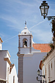 'A Bell Tower In A White Building; Lagos Algarve, Portugal'