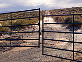 'Metal Gate Locked On A Dirt Road In Glen Canyon National Recreation Area; Utah, United States of America'