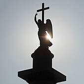'Silhouette Of An Angel Statue And Cross; St. Petersburg, Russia'