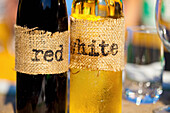 'Homemade Wine Bottles With Burlap Labels; Vancouver, British Columbia, Canada'