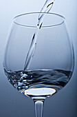 'Pouring Water Into A Glass; Tarifa, Cadiz, Andalusia, Spain'
