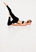 'A Woman In A Yoga Pose; Tarifa, Cadiz, Andalusia, Spain'