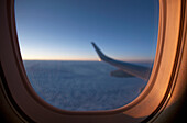 'View From Cabin Of Embraer 190 Aircraft At Sunset; Manitoba, Canada'